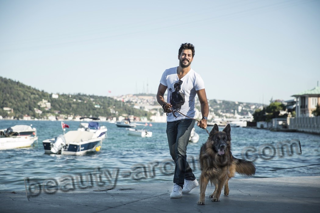 Burak Ozcivit photo with dog