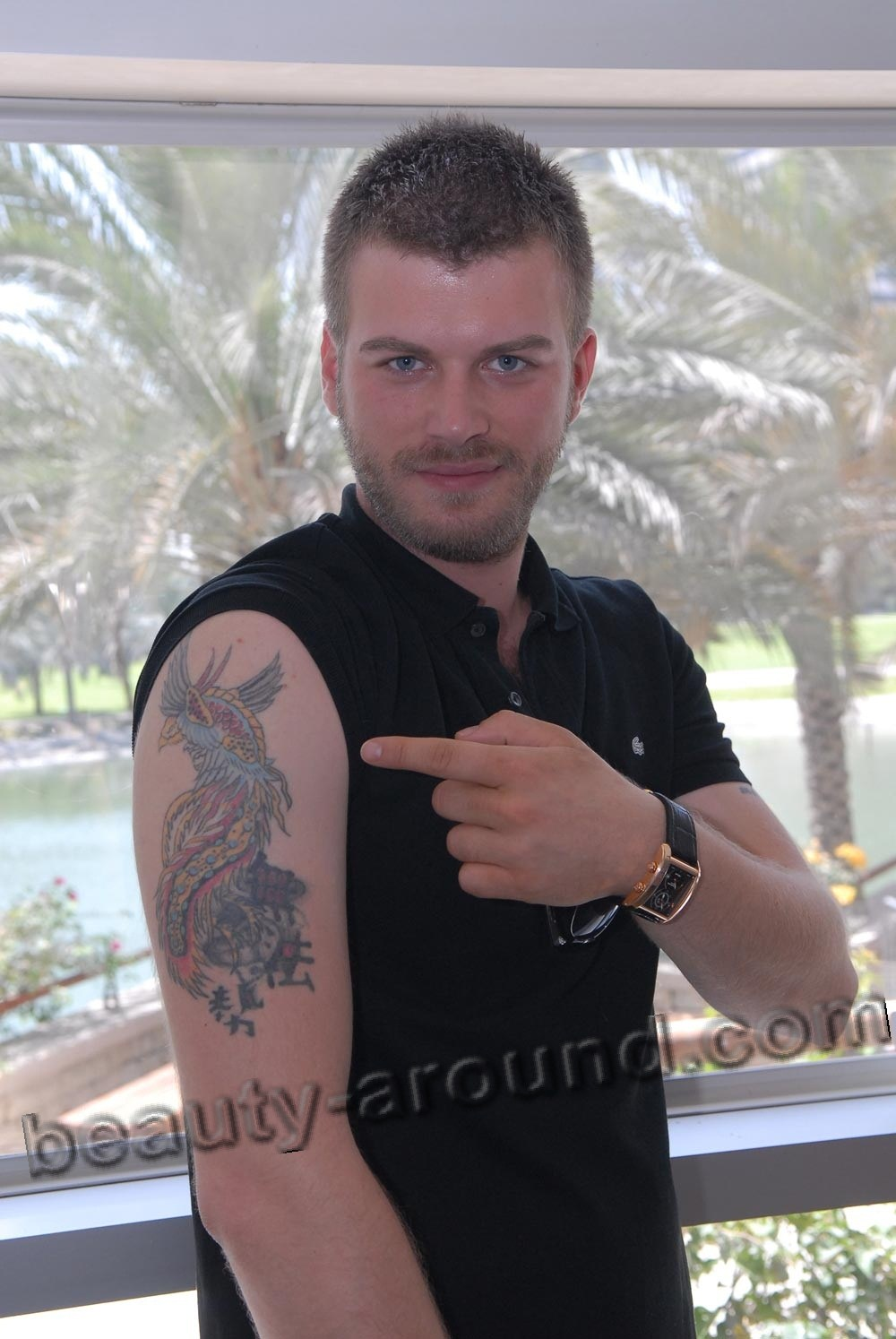 Kivanc Tatlitug Turkish actor, model,photo with a tattoo