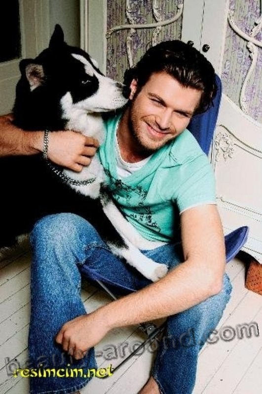 Kivanc Tatlitug Turkish actor, model, photo with dog