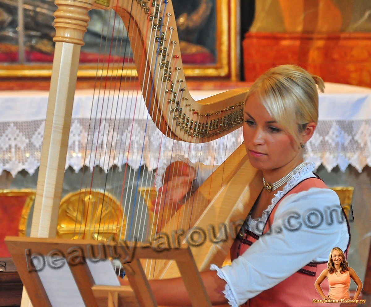 biathlete Magdalena Neuner plays the harp