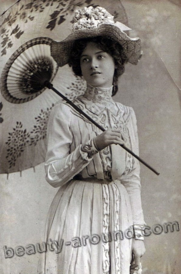 Vintage photo of a girl with an umbrella