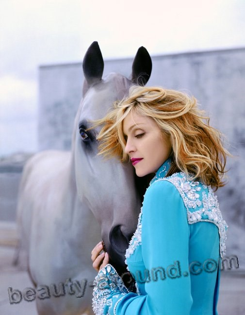 American singer Madonna photo with horse
