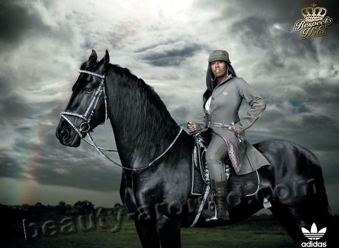 Missy Elliott sits astride on a beautiful black horse photos